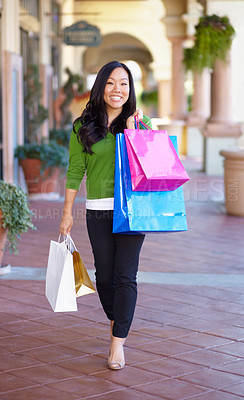 Buy stock photo Full length image of an asian woman on a shopping spree