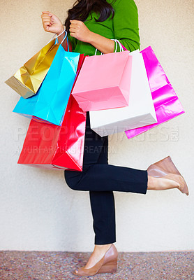 Buy stock photo Cropped image of a woman holding a bunch of shopping bags