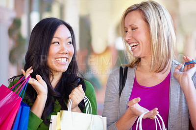 Buy stock photo Two young woman shopping and smiling happily