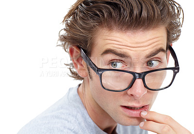 Buy stock photo Handsome young man wearing glasses touching his lip and looking pensive