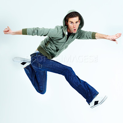 Buy stock photo Portrait of a young man posing while jumping in the air