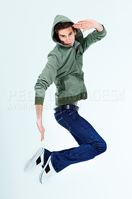 Buy stock photo Portrait of a young man posing in the air