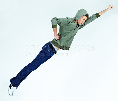 Buy stock photo A young man flying in the superhero pose