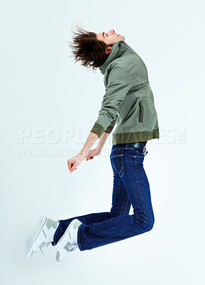 Buy stock photo A young man jumping while looking upwards