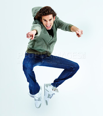 Buy stock photo Portrait of a young man jumping up in the air while pointing at you