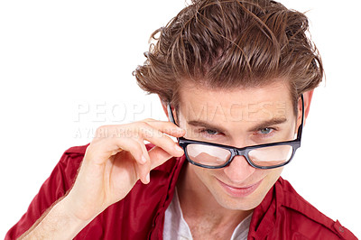 Buy stock photo Young man peering over his glasses at the camera - portrait