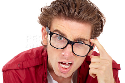 Buy stock photo Young man looking confused and touching his glasses