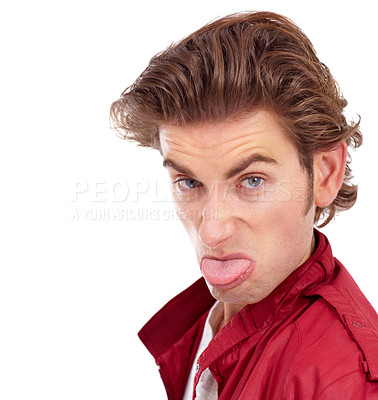 Buy stock photo Handsome young man sticking out his tongue at the camera