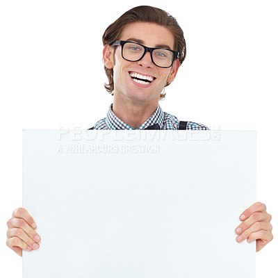 Buy stock photo A happy young man proudly holding up a blank sign for your ad