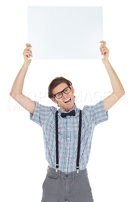 Buy stock photo Portrait of an excited young man holding up a blank sign