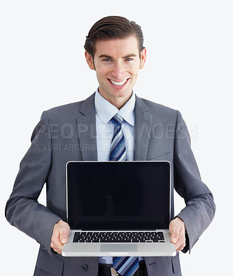Buy stock photo A young businessman presenting a laptop to you