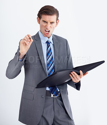 Buy stock photo An angry business manager pointing at you furiously