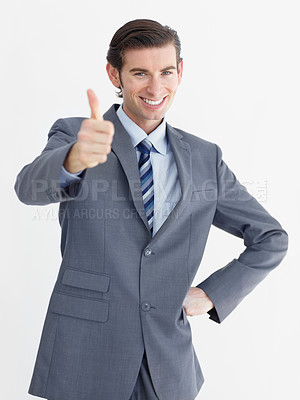 Buy stock photo A young businessman giving you a thumbs up while isolated on a white background
