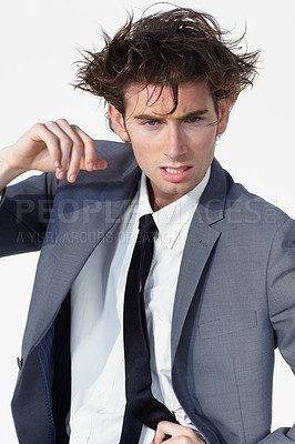 Buy stock photo A disheveled businessman looking at you while isolated on a white background