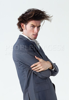 Buy stock photo A young businessman with crazy hair standing on a white background