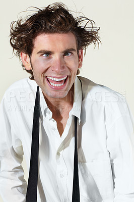 Buy stock photo Portrait of a disheveled young man looking at you manically