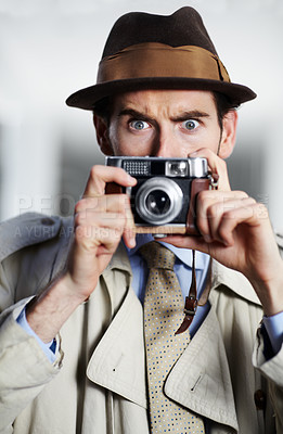 Buy stock photo Private detective capturing a photo using a retro camera