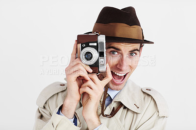 Buy stock photo Reporter taking a photo with a retro camera against a white background with a funny expression