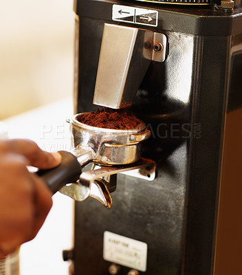 Buy stock photo Cropped shot of a barista preparing ground coffee for brewing