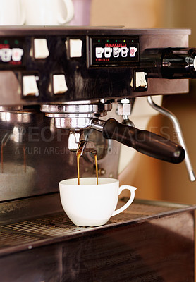 Buy stock photo Shot of freshly brewed coffee dripping into a cup