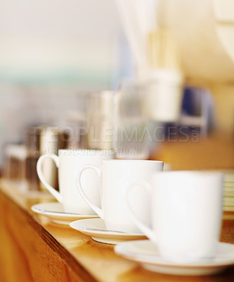 Buy stock photo Shot of a row of expresson cups sitting in a row on a counter