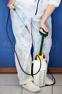 Buy stock photo Cropped image of a person in protective gear preparing a fumigator