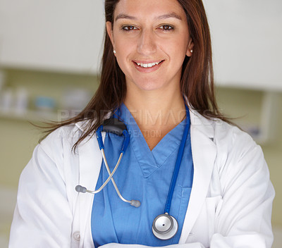 Buy stock photo A portrait of a young female doctor smiling at the camera