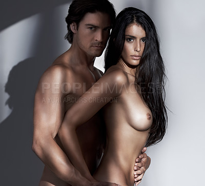 Buy stock photo A naked man and woman holding each other passionately