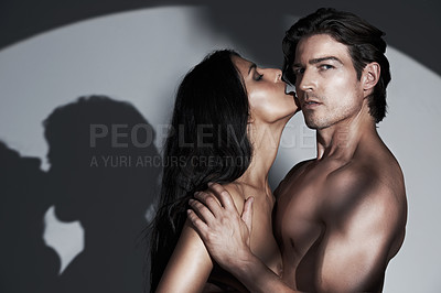 Buy stock photo A young nude woman licking her husband's cheeck