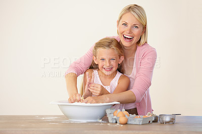 Buy stock photo Portrait of a mother and daughter having fun while baking together