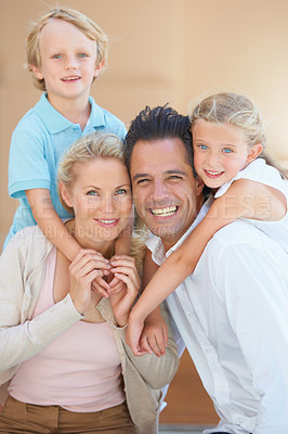 Buy stock photo Two delighted parents spending time with their cute children