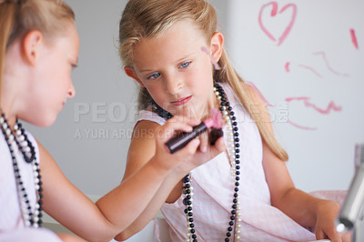 Buy stock photo Naughty little girl drawing on a mirror with her mother's lipstick