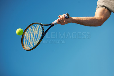 Buy stock photo Shot of a arm hitting a tennis ball with a racket