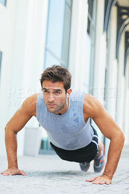 Buy stock photo Toned young man doing push-ups - copyspace