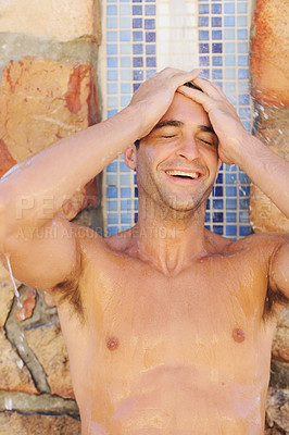 Buy stock photo Handsome young topless man taking an outdoor shower