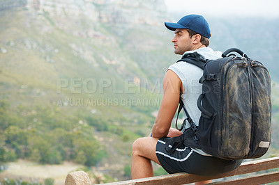 Buy stock photo Young hiker having a rest and enjoying the view - copyspace