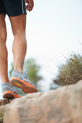 Buy stock photo Cropped image of a hiker's legs standing on a rock - copyspace