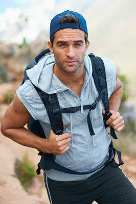 Buy stock photo Young hiker wearing a backpack looking at the camera