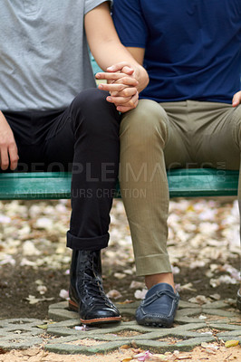 Buy stock photo Cropped view of a homosexual couple holding hands