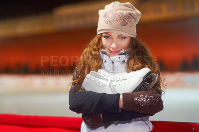 Buy stock photo Portrait of a beautiful young woman standing in an ice skating rink