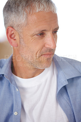 Buy stock photo Closeup of a handsome mature man looking out of frame
