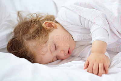 Buy stock photo An adorable baby fast asleep on the bed