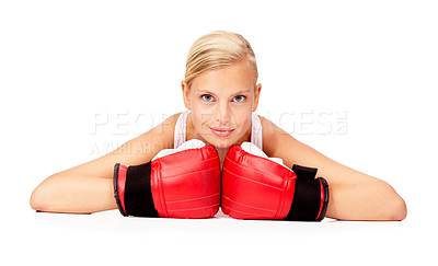 Buy stock photo Portrait of a beautiful woman lying on the floor while wearing boxing gloves