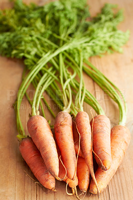 Buy stock photo Carrots on a countertop