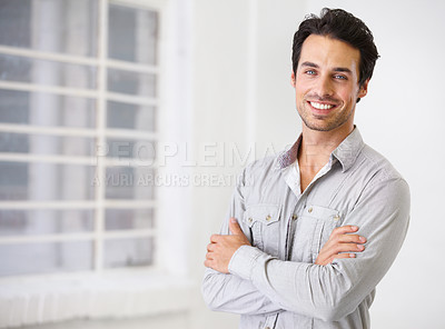 Buy stock photo Portrait of a smiling handsome man with his arms crossed