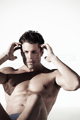 Buy stock photo A muscular male doing sit ups