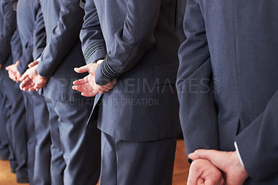 Buy stock photo Shot of a group of air force personnel standing at ease