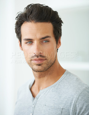 Buy stock photo Head and shoulder shot of a handsome young man looking away
