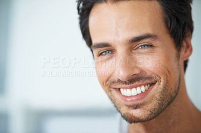 Buy stock photo Closeup portrait of a handsome young man with a charming smile