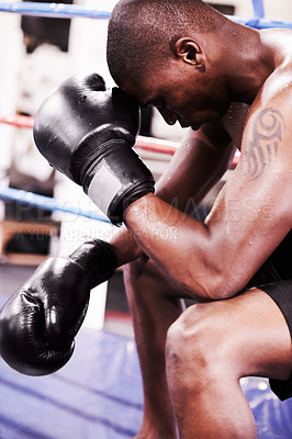 Buy stock photo A boxer taking a moment after losing a fight